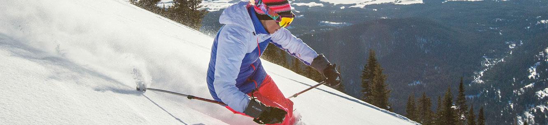 man hikes in snow wearing TurboDown (tm)